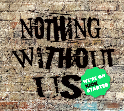 ID: Brick wall with black graffiti that says Nothing Without Us.
