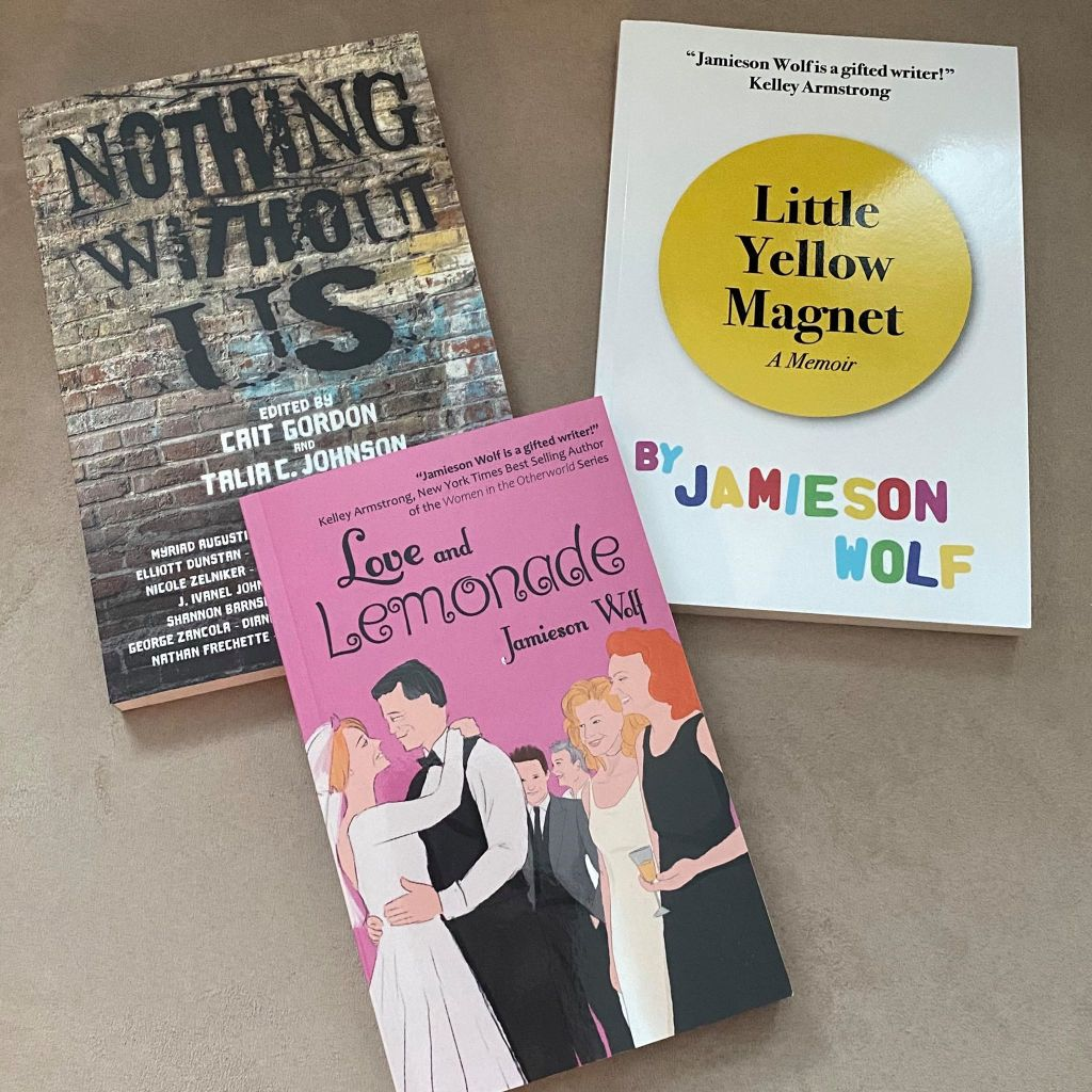 Paperbacks of Nothing Without Us, Little Yellow Magnet, and Love and Lemonade.