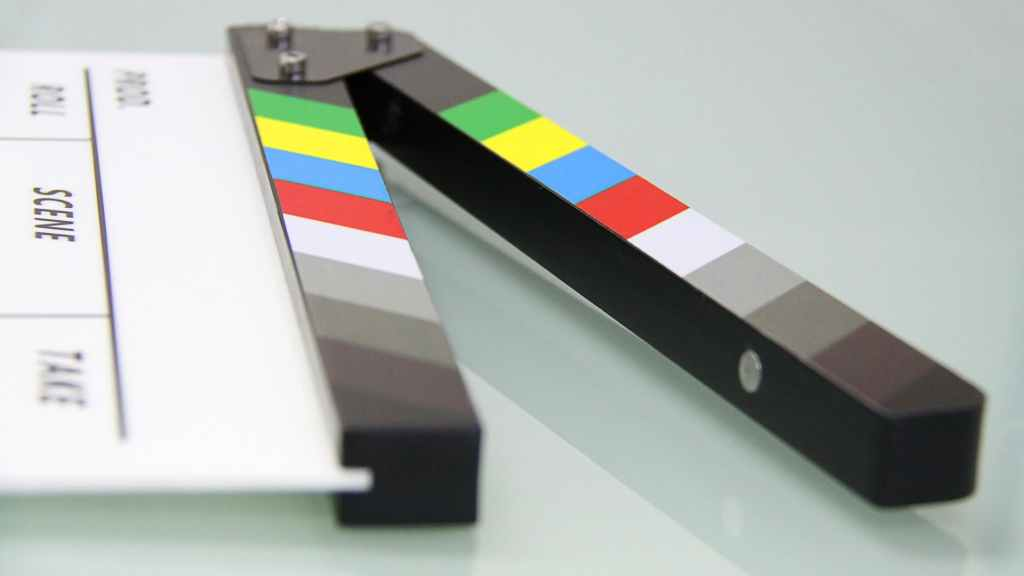 ID: Cinematography clapper board resting on its side on a table